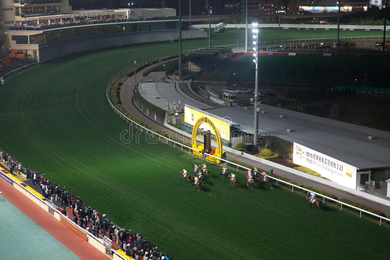 Happy Valley Racecourse, Hong Kong. Happy Valley Racecourse at night.Happy Valley racing is so popular that thousands of racegoers will come to enjoy the party stock images