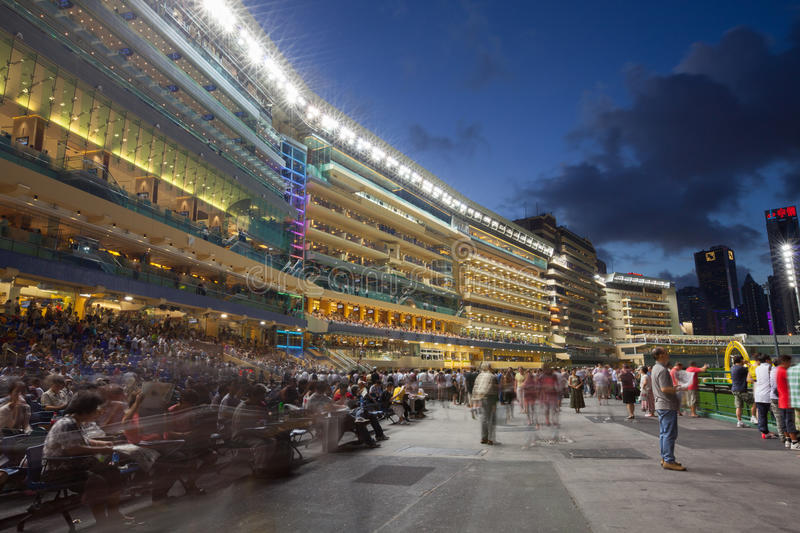 Happy Valley Racecourse in Hong Kong. A bustling scene from the Happy Wednesday Finale. Happy Valley Racecourse is one of the two racecourses for horse racing royalty free stock photo