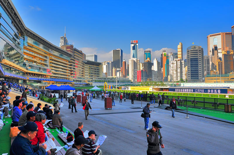 Happy valley racecourse, hong kong. Horse racing enthusiasts at the happy valley racecourse, built in 1845 and rebuilt in 1995, a world-class horse racing royalty free stock photography