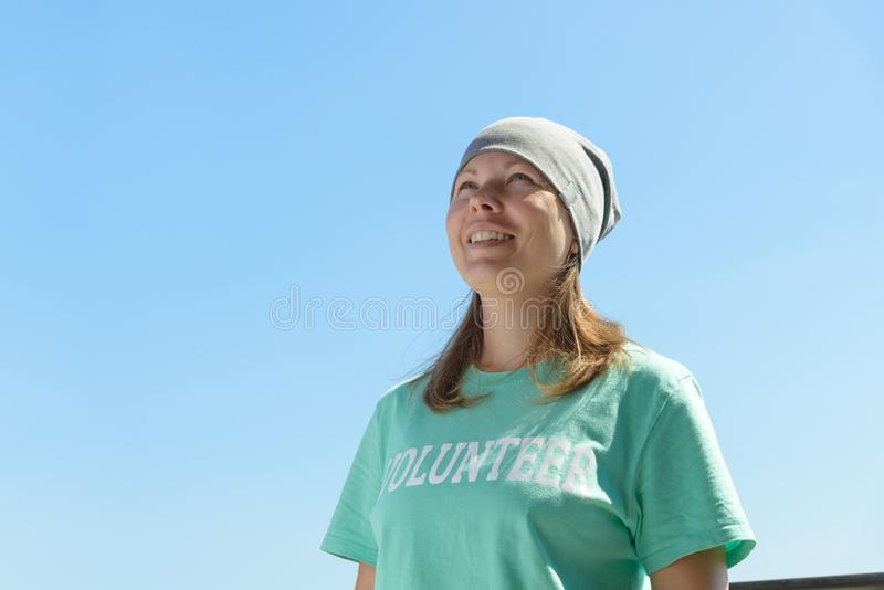 A happy volunteer woman outdoors portrait stock images