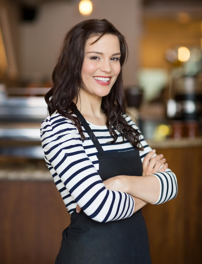 Happy Waitress Standing In Cafe royalty free stock photos