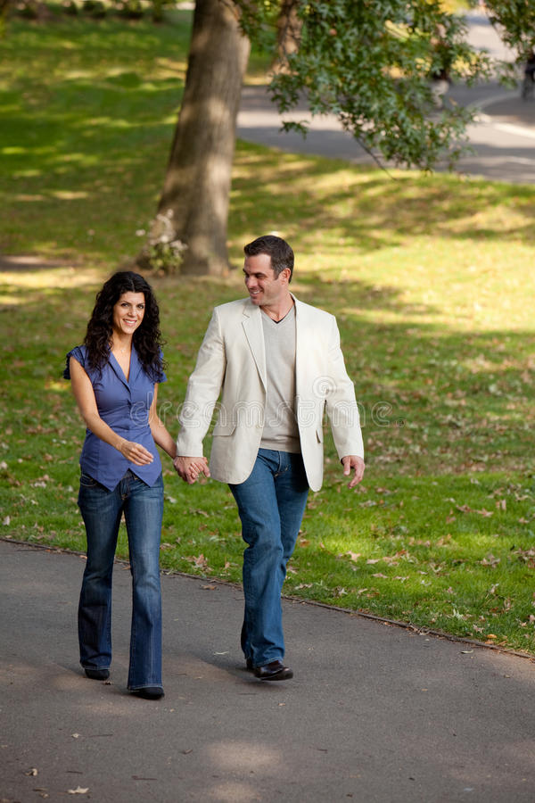 Happy Walk People. A happy couple walking in the park royalty free stock images