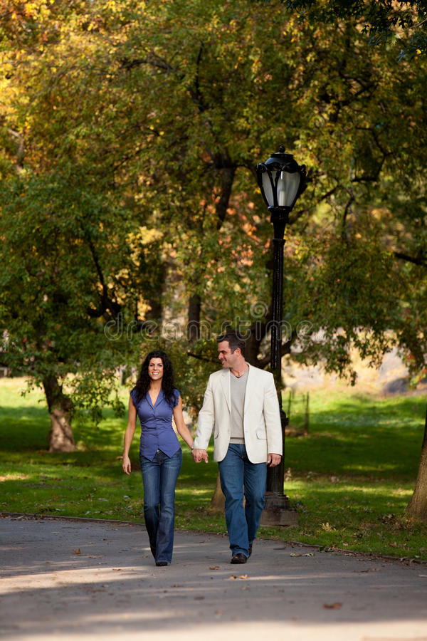 Happy Walk People. A happy couple walking in the park royalty free stock image