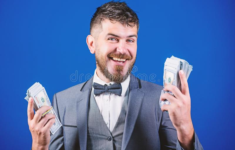 Happy and wealthy. Rich businessman with us dollars banknotes. Bearded man holding cash money. Currency broker with. Bundle of money. Making money with his own stock photo