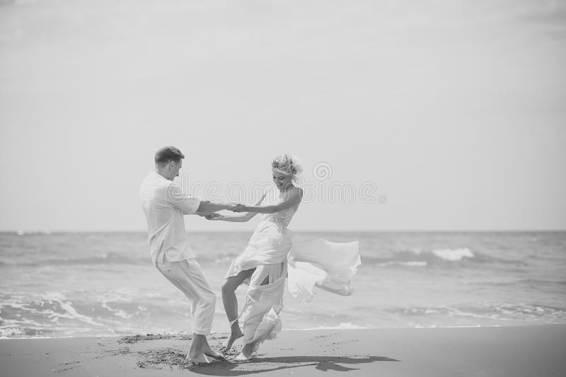 Happy wedding couple on beach royalty free stock photography