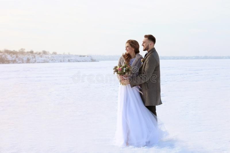 Happy wedding couple outdoors royalty free stock images