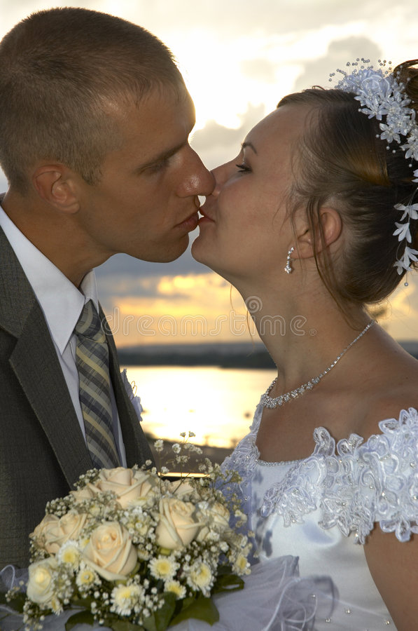 Happy wedding kiss stock photos