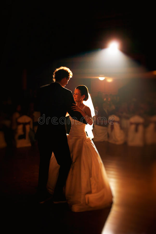 Wedding party dance. Bride and groom in happy wedding party dance