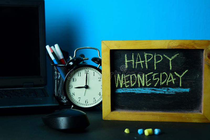 Happy Wednesday Planning on Background of Working Table with Office Supplies. Business Concept Planning on Blue Background royalty free stock photography