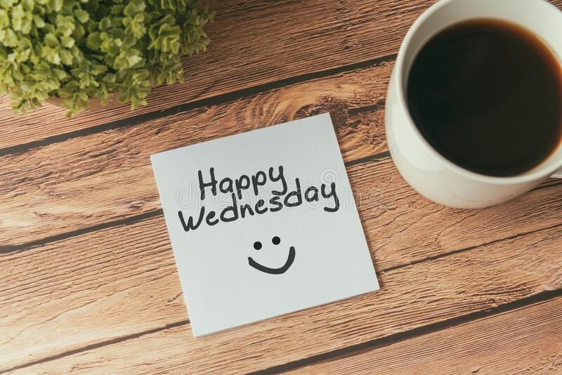 Happy Wednesday with smile greeting on paper note. With cup of coffee stock image