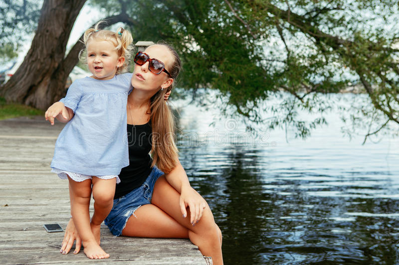 Happy white Caucasian mother and daughter child having fun outside royalty free stock images