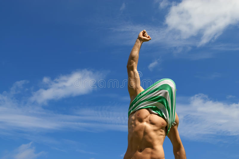 Happy winner with shirt on his head royalty free stock photo