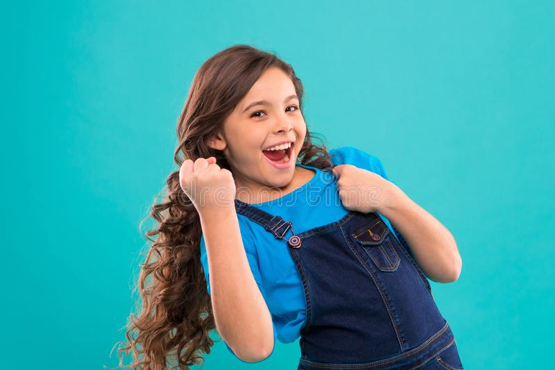Happy winner. Successful happy kid. Achieve success. Kid cheerful celebrate victory. Girl cute child long curly hair royalty free stock images