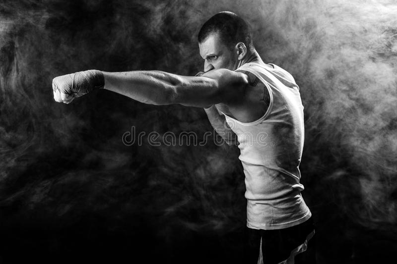 Happy Winning Mixed Martial Arts Fighter Punching in Smoke royalty free stock photos