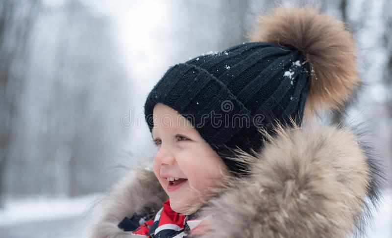 Happy winter child. Cute boy in winter. Child boy outdoor portrait. Winter emotion. royalty free stock photography