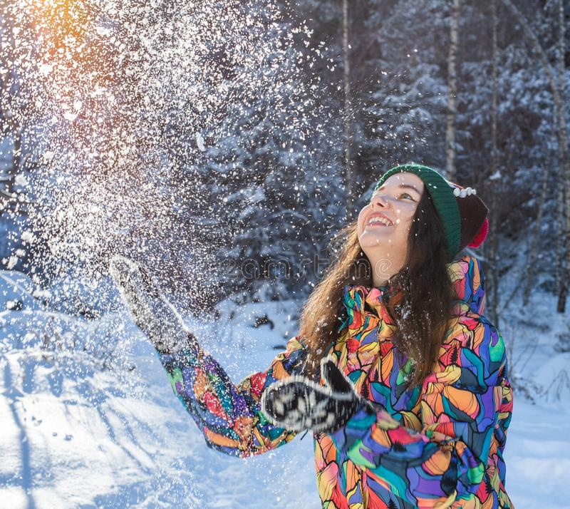 Happy winter fun woman throwing snow banner. Panorama crop of outdoor lifestyle girl playing in snow outside laughing in stock photo