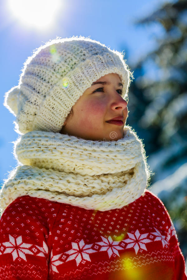 Happy winter girl wearing knitted wear scarf. royalty free stock photo