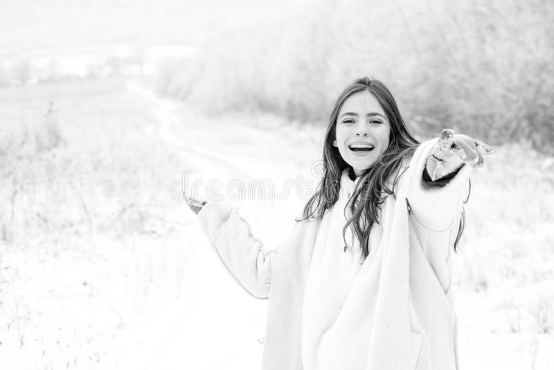 Happy Winter Girl. Happy winter woman on on snowy background. Outdoor beautiful girl with long hair wearing sweater royalty free stock images