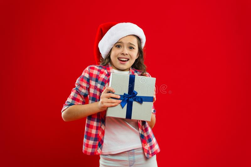 Happy winter holidays. Being surprised. Small girl. New year party. Santa claus kid. Christmas shopping. Present for. Xmas. Childhood. Little girl child in royalty free stock images