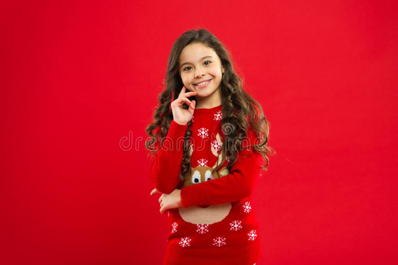 Happy winter holidays. Christmas is coming. Favorite sweater. Small girl. Present for Xmas. Childhood. Little girl child stock photo