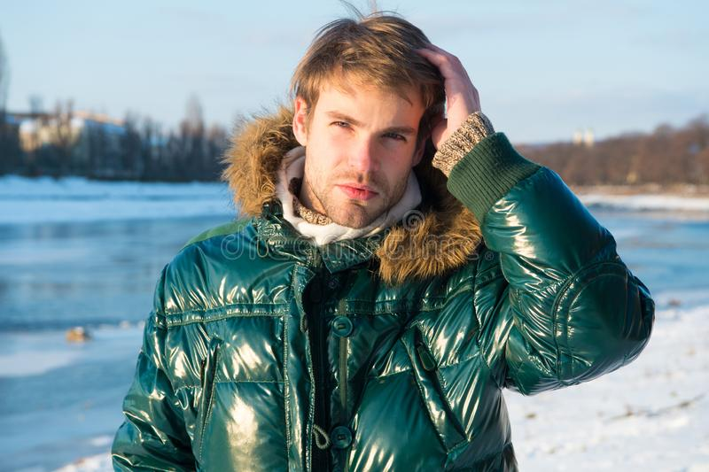 Happy winter holidays. Flu and cold. Winter fashion. Green warm coat. Warm clothes for cold season. Man traveling in stock photos