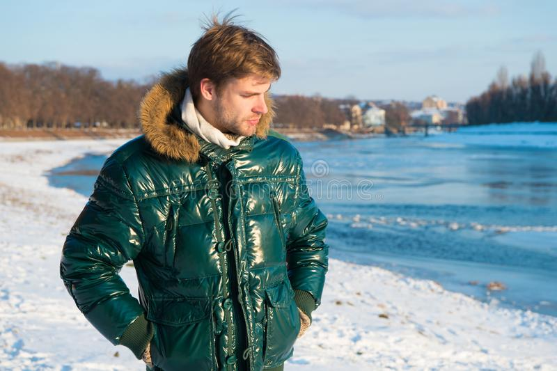 Happy winter holidays. Flu and cold. man in winter clothes. Winter fashion. Green warm coat. Warm clothes for cold royalty free stock photo