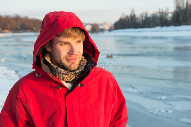 Happy winter holidays. Flu and cold. man in winter clothes. Winter fashion. red warm coat. Warm clothes for cold. Season. Man traveling in winter, nature. Look royalty free stock photography
