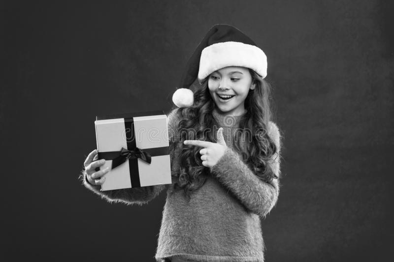 Happy winter holidays. New year new goals. Small girl. Present for Xmas. Childhood. Little girl child in santa red hat stock photography