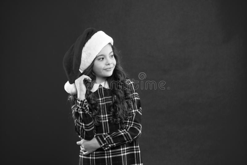 Happy winter holidays. Small girl. Little girl child in santa red hat. New year party. Santa claus kid. Present for Xmas royalty free stock image