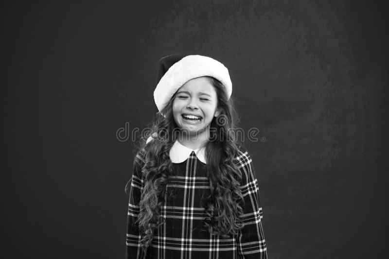 Happy winter holidays. Small girl. Little girl child in santa red hat. New year party. Santa claus kid. Present for Xmas stock image