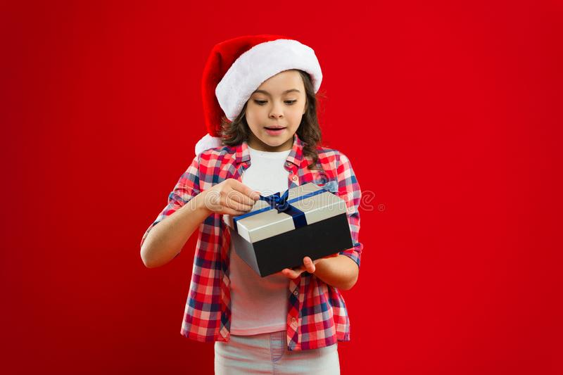 Happy winter holidays. Small girl. New year party. Santa claus kid. Christmas shopping. Present for Xmas. Childhood stock image