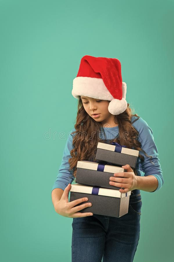 Happy winter holidays. Small girl. Present for Xmas. Childhood. Christmas shopping. Little girl child in santa hat. New stock images