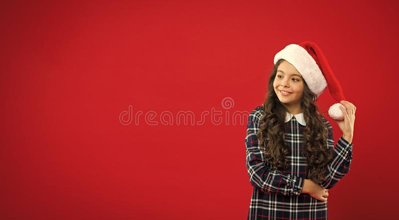Happy winter holidays. Small girl. Present for Xmas. Childhood. Christmas shopping. Little girl child in santa red hat. New year party. Santa claus kid. Magic royalty free stock photos