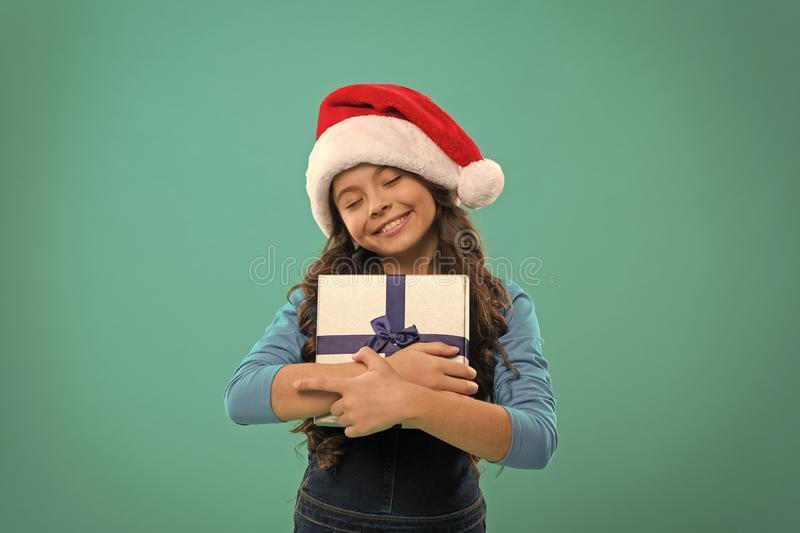 Happy winter holidays. Small girl. Present for Xmas. Childhood. Little girl child in santa hat. Christmas shopping. New royalty free stock photography