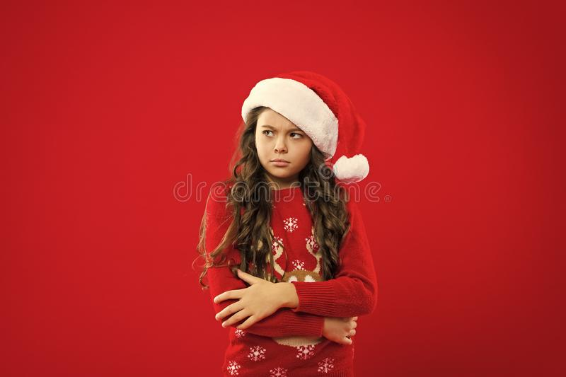 Happy winter holidays. Small girl. Present for Xmas. Childhood. Little girl child in santa red hat. New year party royalty free stock photography