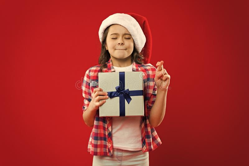 Happy winter holidays. Small girl. Present for Xmas. Childhood. New year party. Santa claus kid. Christmas shopping royalty free stock images