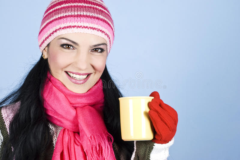 Happy winter woman holding hot drink royalty free stock image