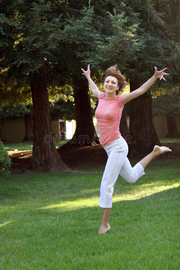 Happy woman. Running on grass royalty free stock photo