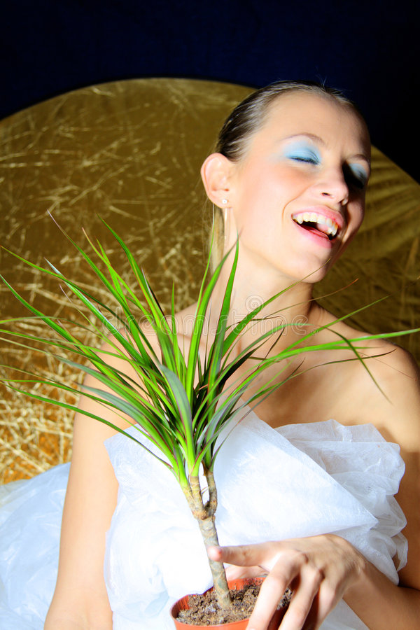 Happy woman. Happy green peace woman caring plant in flowerpot stock photos