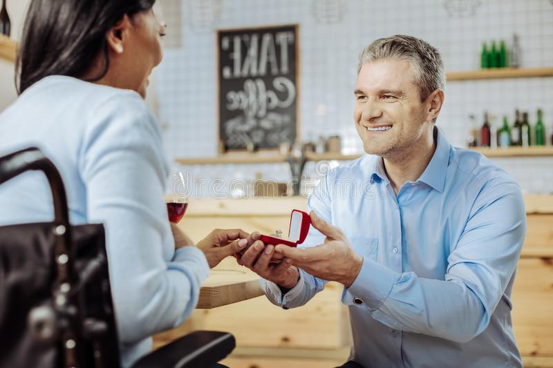 Happy woman accepting a proposal from a man stock photo