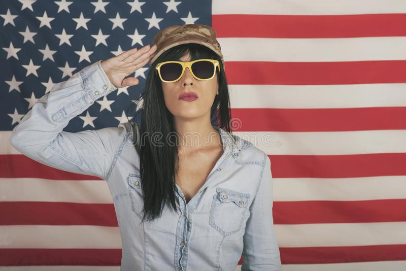 Happy woman on American flag background royalty free stock photo