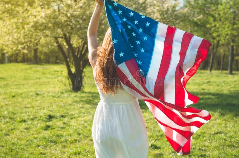 Happy women with American flag USA celebrate 4th of July. Happy woman with American flag USA celebrate 4th of July royalty free stock photos