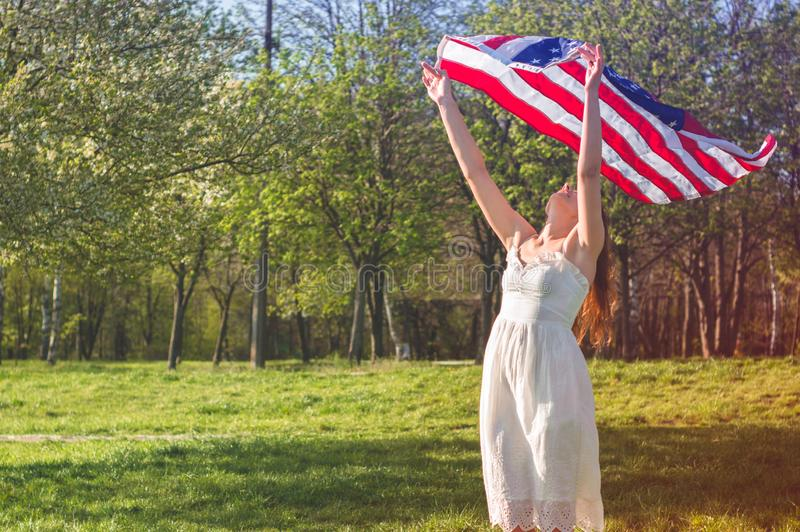 Happy women with American flag USA celebrate 4th of July. Happy woman with American flag USA celebrate 4th of July royalty free stock image