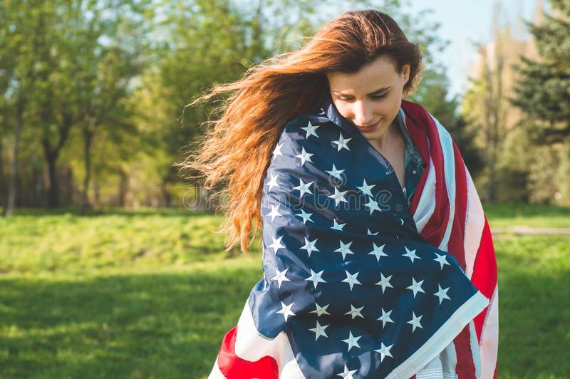 Happy women with American flag USA celebrate 4th of July. Happy woman with American flag USA celebrate 4th of July royalty free stock images