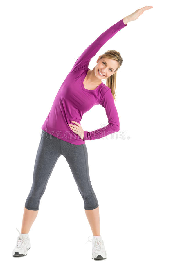 Happy Woman With Arms Raised Doing Stretching Exercise
