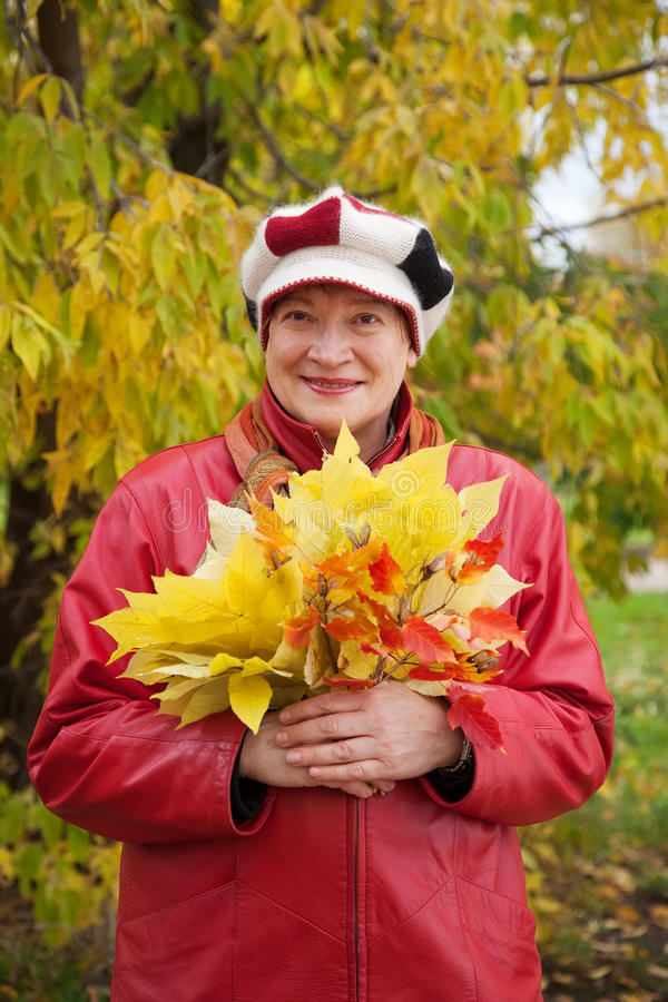 Download Happy woman in autumn stock image. Image of mature, smile - 39511567