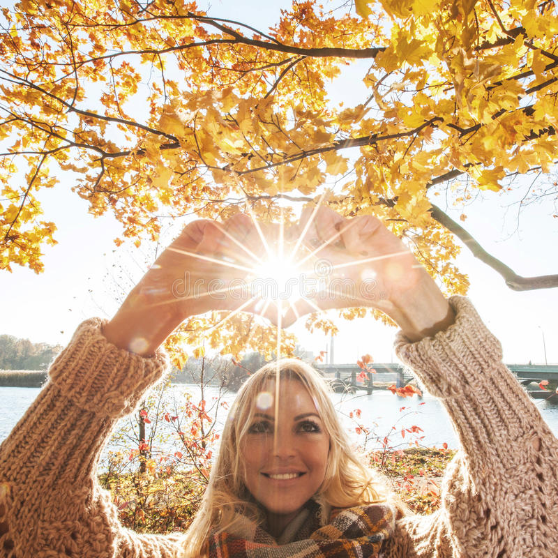 Happy woman in autumn park stock photography