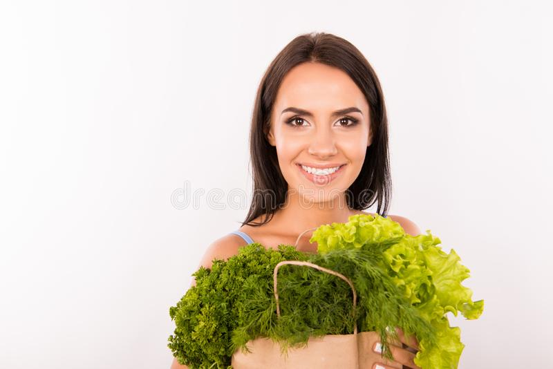 Happy woman with bag full of greens and vegetables stock photo