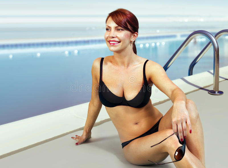 Happy woman in bathing suit relaxing royalty free stock images