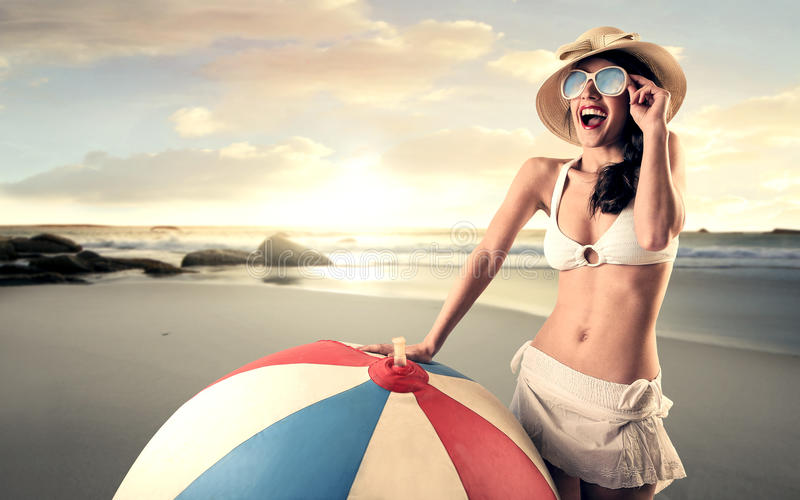 Happy woman at the beach stock image